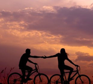 Couple on bikes sunset